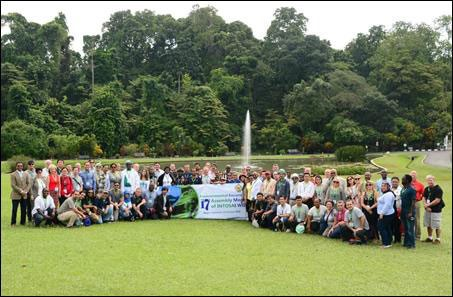 The delegates took a picture on the environmental excursion in Bogor Botanical Garden.
